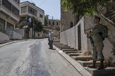 A Palestinian man near one of the many checkpoints in Hebron.