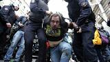 Image: A protester is detained in St. Petersburg, Russia