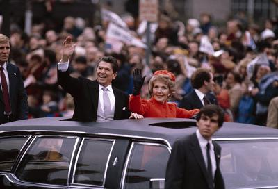 President Ronald Reagan and wife Nancy wave to the crowd as they drive down Pennsylvania Avenue in Washington during the inaugural parade on Jan. 20, 1981.
