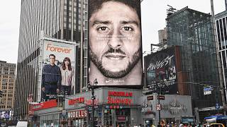 Image: A Nike ad featuring Colin Kaepernick is on display on top of a Model
