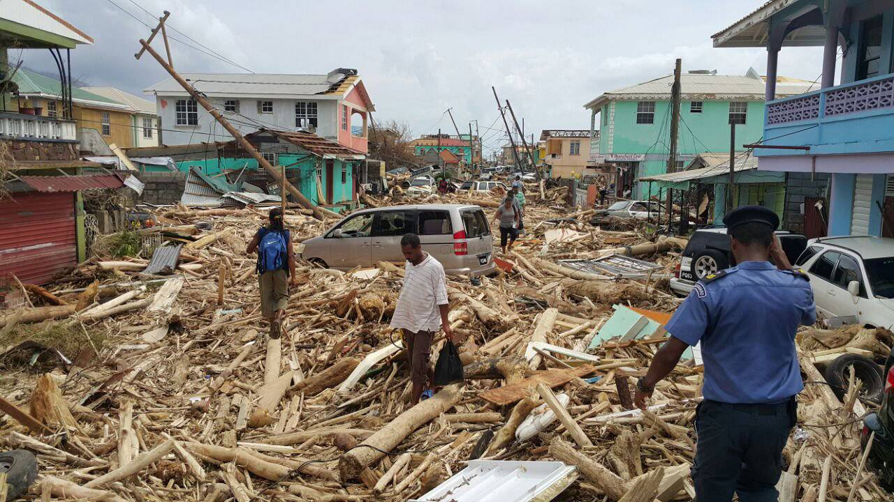 Resident survey damage from Hurricane Maria in Roseau, Dominica, on Sept. 2
