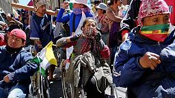 Bolivian police use tear gas on disabled protesters demanding a rise in state benefits