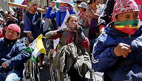 nocomment: Bolivian police use tear gas on disabled protesters demanding a rise in state benefits