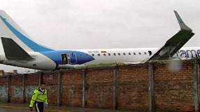 Plane skids off runway in Ecuador