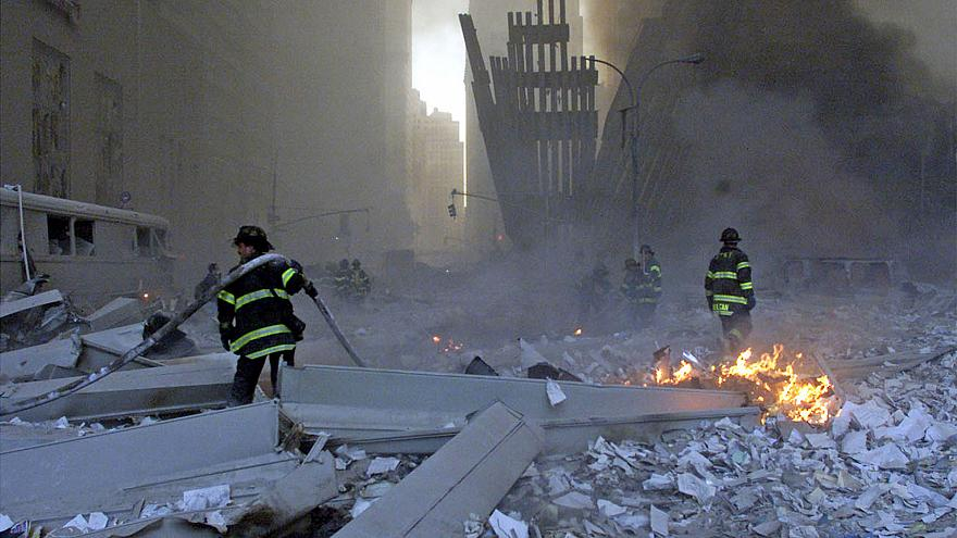 Image: File picture shows firemen working around the World Trade Center aft