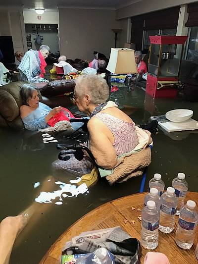 Residents of the La Vita Bella nursing home in Dickinson, Texas, sit in waist-deep flood waters caused by Hurricane Harvey on Aug. 27, 2017. Authorities said all the residents were safely evacuated from the facility.