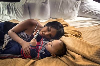 Thaliana Cruz, 21, and her son, Dathbrian Rivera, 1, facetime with Cruz\'s brother, who is still in Puerto Rico, from a Hartford, Conn. hotel on December 19, 2017.