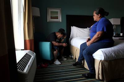 Miguel Alvarez and his wife, Liz Vazquez, in a hotel room in Orlando, Florida, on Dec. 6, 2017. The couple went to Florida with their two sons after Hurricane Maria hit Puerto Rico in September 2017. The hotel provided temporary housing for displaced Puerto Ricans.