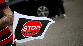 Latin American cabbies step up protests over Uber