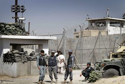 Afghan policemen in front of the main prison in Kandahar, south of Kabul, Afghanistan, on April 25, 2011.