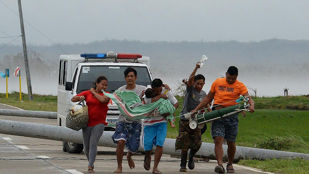 Powerful typhoon kills at least 12 in Philippines