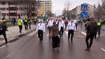 Lone woman faces down neo-Nazis in Sweden