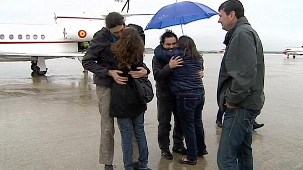 Journalists freed in Syria return home to Spain