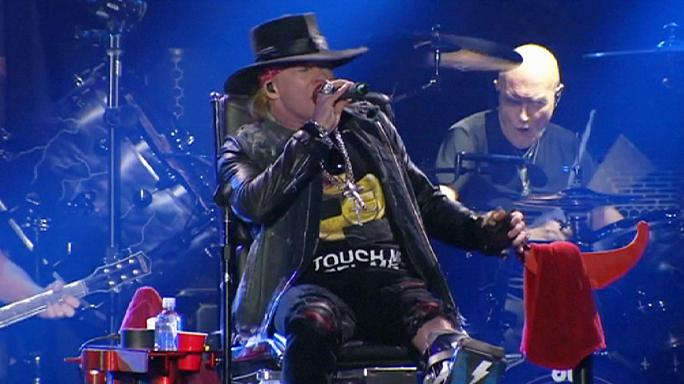 'Enthroned' Axl Rose rocks in AC/DC debut in Lisbon