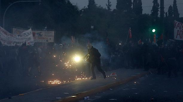 Protests turn violent as Greek parliament prepares to vote on new austerity measures