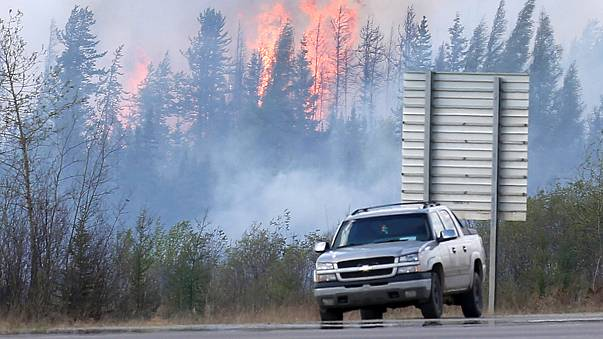 Change in weather helps fight Canada wildfire