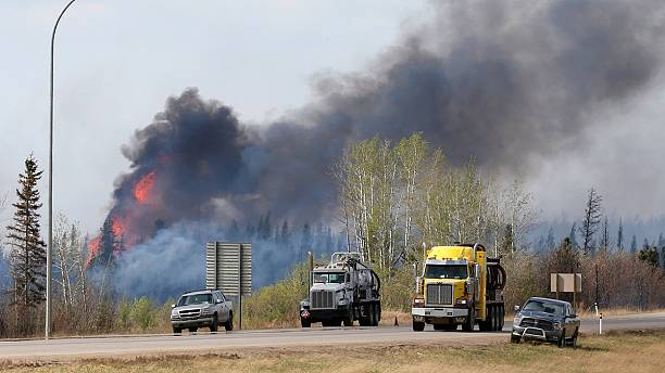 Canada: firefighters optimistic cooler temperatures will help battle blazing inferno