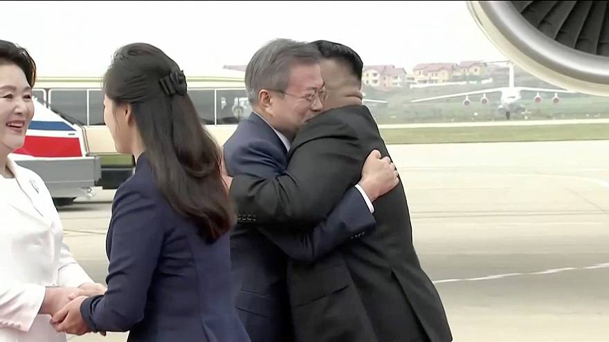 Image: North Korean leader Kim Jong Un and his wife Ri Sol Ju greet South K