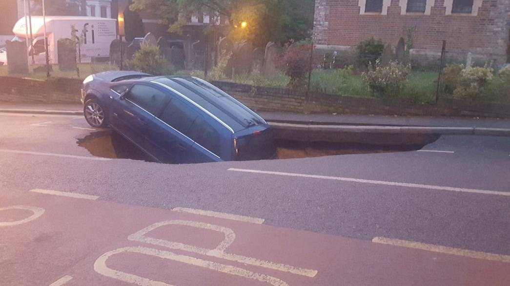 A car in London just got swallowed by a sink hole