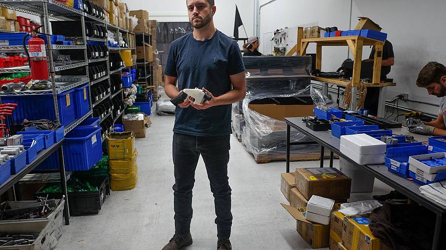 Image: Cody Wilson, owner of Defense Distributed company, holds a 3D printe