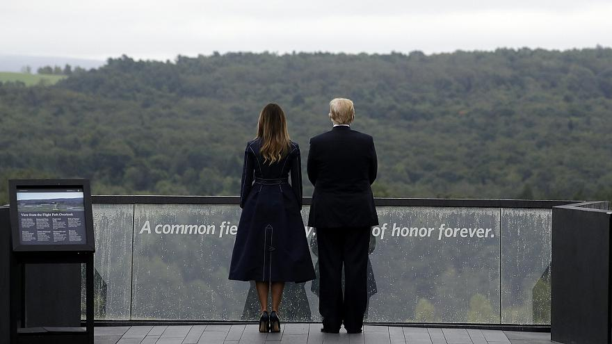 Image: President Donald Trump and first lady Melania Trump, stand along the
