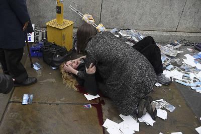 A woman lies injured after a shooting incident on Westminster Bridge in London on March 22, 2017.