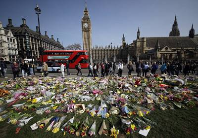 Floral tributes to the victims of the Westminster attack are placed outside the Palace of Westminster, London, Monday March 27, 2017. Attacker Khalid Masood is believed to have used the messaging service WhatsApp before running down pedestrians on Westminster Bridge and storming a gate outside Parliament armed with two knives, Wednesday. Four died in the rampage, including a police officer. (AP Photo/Matt Dunham)