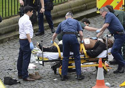 Attacker Khalid Masood is treated by emergency services outside the Houses of Parliament in London on March 22, 2017.