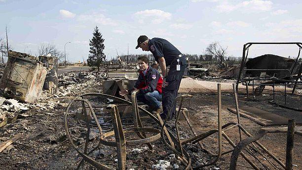 Canada PM Justin Trudeau tours wildfire-ravaged Alberta