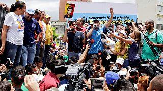 Venezuela president threatens to seize factories as opposition pushes for referendum