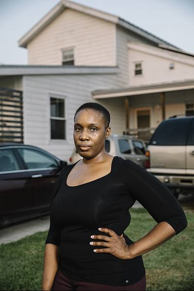 Kamaria Allen stands in front of the home on Jourdan Street that her parents bought from the Make It Right Foundation in New Orleans.