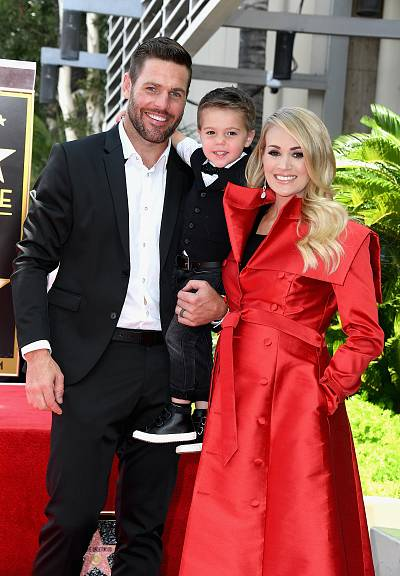 The pregnant country singer attended the milestone event with her hubby, Mike Fisher, and their son,  Isaiah.