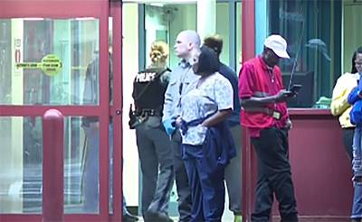 In this grab from video, people stand near an entrance to Upstate University Hospital after multiple victims shot in Syracuse, NY on September 20, 2018.