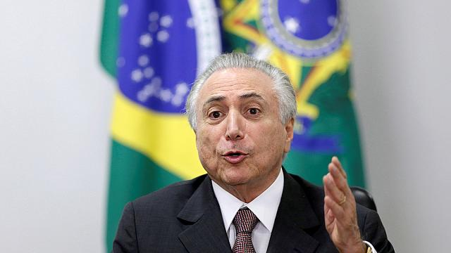 Brazil's interim president woos union leaders