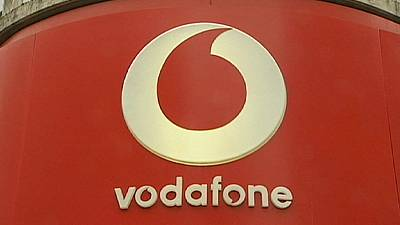Vodafone's underlying earnings rise, losses through Luxembourg tax hit