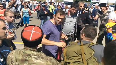 Russian opposition leader Navalny attacked by Cossacks