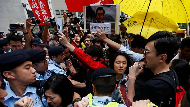 Scuffles in Hong Kong as protesters try to approach Chinese official