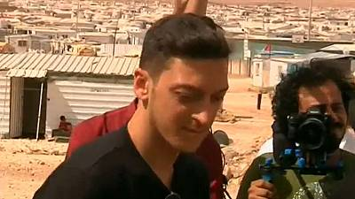 Soccer star Mesut Ozil has kickabout with young Syrian refugees
