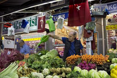 A trader sprinkles vegetables with water in Bursa, Turkey.