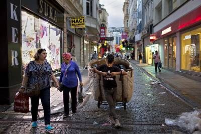 Garbage economy: A young man pauses while collecting trash near Istanbul\'s Spice Bazaar.