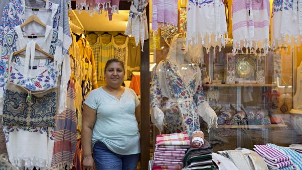 Image: Pembe Cavdar waits for customers at her Bursa clothing store