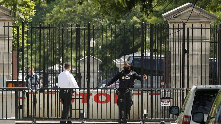 Lockdown at White House after armed man shot at checkpoint