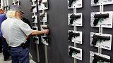 Clinton slams Trump on guns