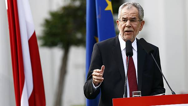 Austria's president-elect talks of uniting his divided country