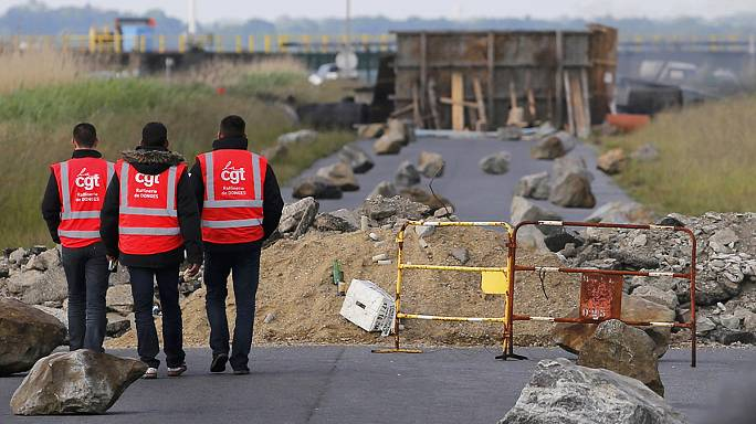 French nuclear workers vote to join strike against labour laws