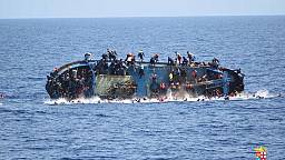 Migrant rescue from capsized boat is caught on camera