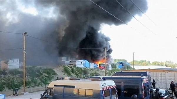 Afghan and Sudanese migrants battle in Calais camp