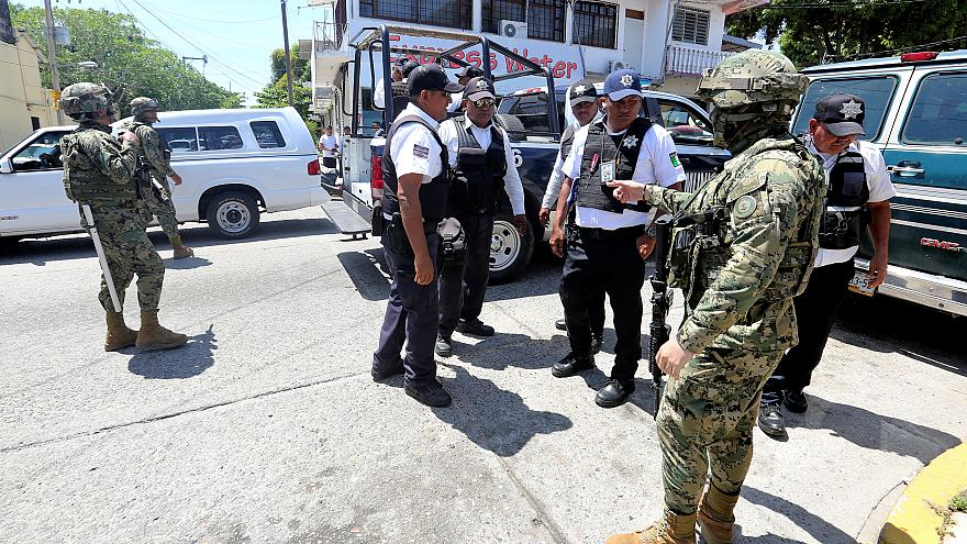Mexican Marines escort municipal police officers disarmed and detained duri