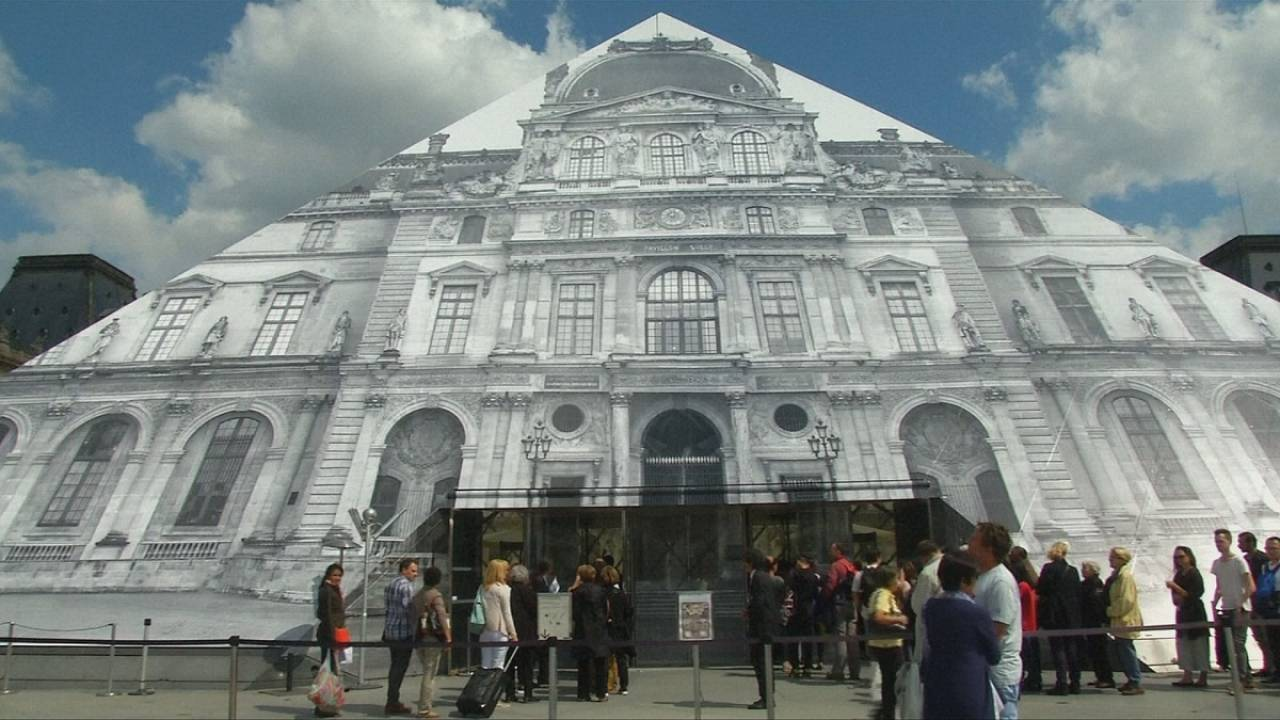 French artist JR makes the Louvre disappear