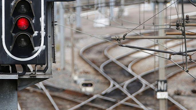 Hollande digs heels in as strikes begin on railways